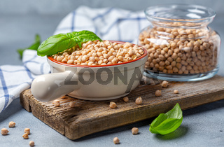 Raw chickpeas and green basil.