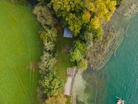 Drone shot of pasture near a lake. Copy space. Switzerland