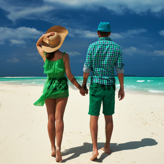 Couple in green on a beach at Maldives