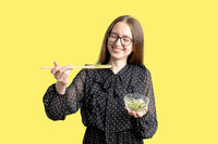 Caucasian young woman with salad isolated on white background. Microgreens superfood