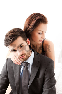 Young woman hugs her boyfriend