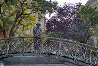 The Imre Nagy statue on a bronze walking bridge in Budapest, Hungary.