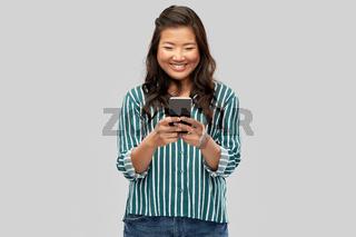 happy asian woman using smartphone