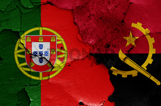 flags of Portugal and Angola painted on cracked wall