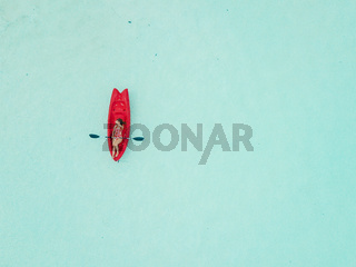 Aerial view of woman kayaking in Bacalar Mexico shot with drone