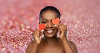 smiling african american woman with red hearts