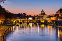 Sunset over the St. Peters Basilica and the river Tiber in Rome