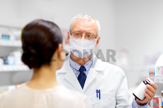 apothecary in mask showing drug to customer