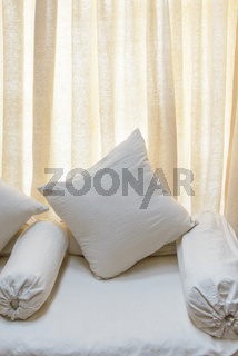 White sofa and cushions