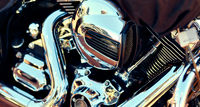Close up background, part of modern chrome shiny engine of motorcycle, full frame, no people