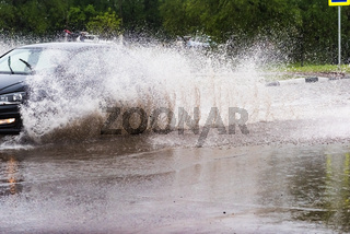 car in a pool of water with splashes