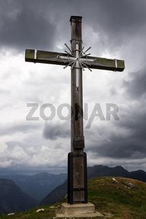 Top and Summit Cross of Mount Hoher Ziegspitz, 1864 m in Ammergauer Alps, in Garmisch-Partenkirchen, Upper Bavaria, Germany