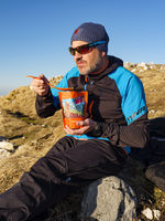 Mountaineer eating a trekking meal