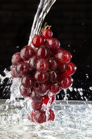 Bunch Of Grapes And Water Stream