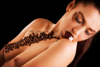 Sexy young woman with coffee beans and sugar