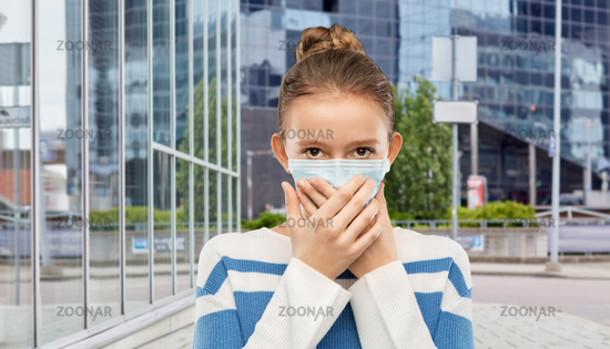 teenage girl in protective medical mask at city