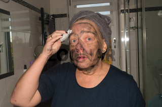 Woman in the spa during treatments with facial mask.