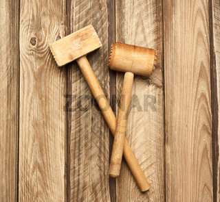 wooden kitchen hammer on a background of gray boards