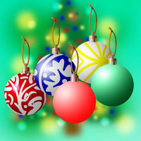 Christmas balls against a Green Blurred Tree