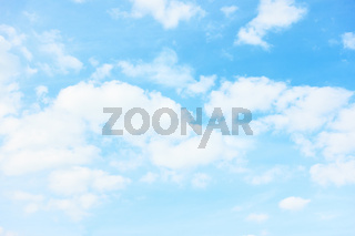 Light pastel blue sky with white clouds