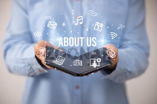Businessman holding a foldable smartphone, social media concept
