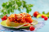 Pepper stuffed with vegetables and rice with tomato sauce.