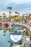 Small leisure boats docked at the canal of picturesque Long Beach California