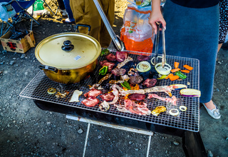 Charcoal-grilled meat image at barbecue