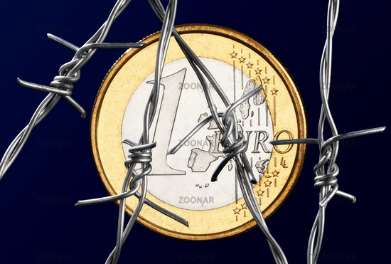 Euro coin behind barbed wire