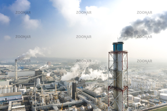 Aerial view of industrial area with chemical plant. Smoking chimney from factory