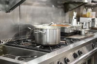 Stainless steel restaurant professional kitchen equipment and work surface.