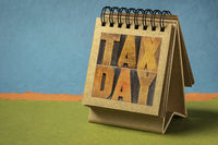 tax day word abstract in a spiral desktop calendar