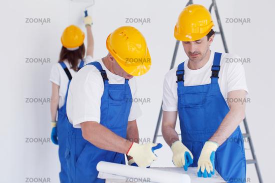 Renovation team with blueprint