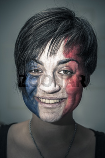 Happy woman with flag of France on face