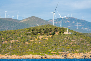 Wind Farms and Lighthouse on a Hilly Shore