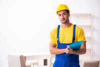 Young male contractor in relocation concept