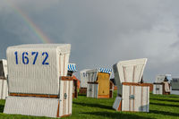 White wicker chairs with rainbow, Buesum, Schleswig-Holstein, Germany