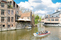 View of the canal and medieval buildings in popular touristic city of Ghent