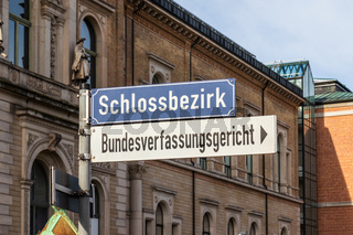 Direction Sign letters to Schlossbezirk and Bundesverfassungsgericht, BGH, engl. Federal Court of Justice of Germany