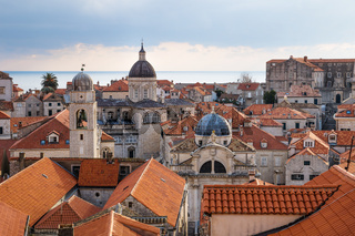View over the orange roofs of old town Dubrovnik with church towers and ocean, Croatia
