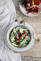 Fresh cucumber salad with dill and pomegranate kernels, in yoghurt sauce