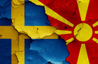 flags of Sweden and North Macedonia painted on cracked wall