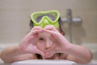 little girl with snorkel goggles