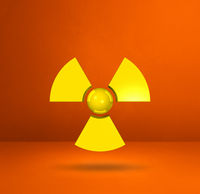Radioactive symbol on a orange studio background