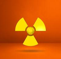 Radioactive symbol on a orange studio background