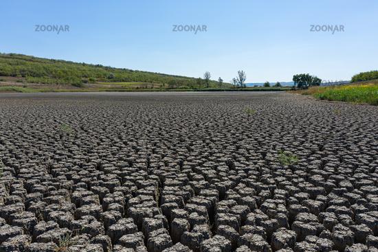 Drought deep cracked earth under blue sky