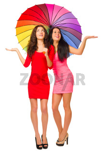 Two young girls with umbrella isolated