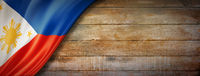 Philippines flag on vintage wood wall banner