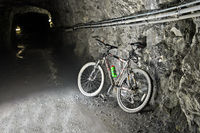 Mountain bike in a construction tunnel of the Mauvoisin water reservoir, Val de Bagnes, Switzerland