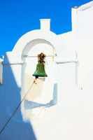 Small bell tower of ancient greek church in Mykonos
